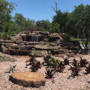 San Antonio hardscape with water features by C & K Lawn Services